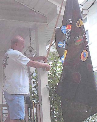 hanginghisflag.jpg